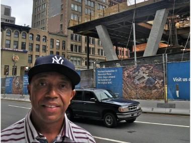 Russell Simmons outside of his Liberty Street apartment, which faces Ground Zero.