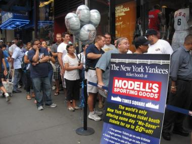 Around 50 fans waited in front of Modell's to buy tickets Monday.