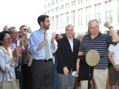 Tenant Ed Rosner stands with Manhattan Borough President Scott Stringer, State Sen. Daniel Squadron, Council Member Margaret Chin as other tenants cheer behind him at Tuesday's press conference.