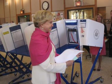 Maloney carries her vote to the scanning machine at the 92nd Street Y during the problem-plagued primary.