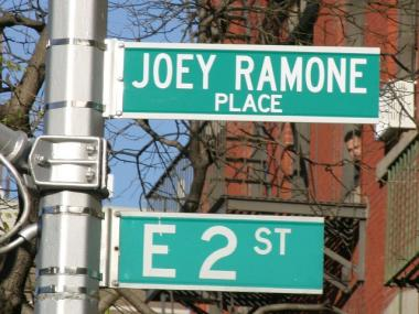 The city had to raise the sign for Joey Ramone Place after people kept stealing it.