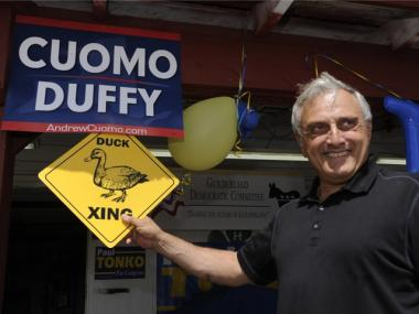 Republican candidate Carl Paladino jokes with supporters outside at the Altamont Fair in Altamont, N.Y., on Aug. 20, 2010. Paladino said opponent Andrew Cuomo was a