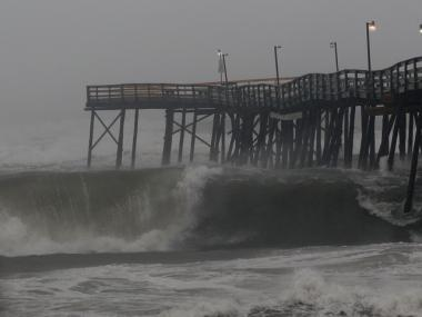 Large waves break under the Avalon Fishing Pier, in Kill Devil Hills, N.C., on Sept. 3, 2010. Hurricane Earl was downgraded to a category 2 before brushing the Outer Banks early Friday morning.