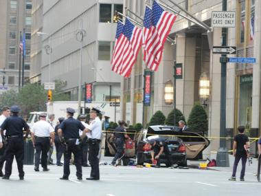 Police officers search the car believed to carry a suspicious package on Park Avenue and East 51st Street Thursday.