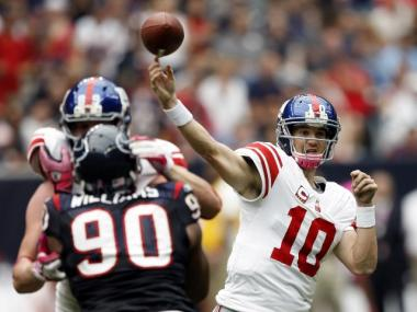 Eli Manning passes the ball against the Houston Texans on Sunday, Oct. 10, 2010.