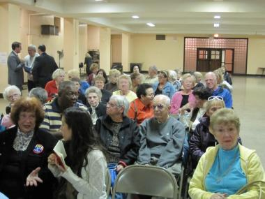 An audience of mostly seniors waits for Congresswoman Carolyn Maloney and Ryan Brumberg to debate Wednesday night in Queens.