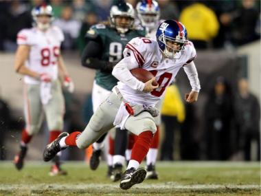 Eli Manning goes to the turf after a run late in the fourth quarter against the Philadelphia Eagles at Lincoln Financial Field on Nov. 21. Manning fumbled on the play.