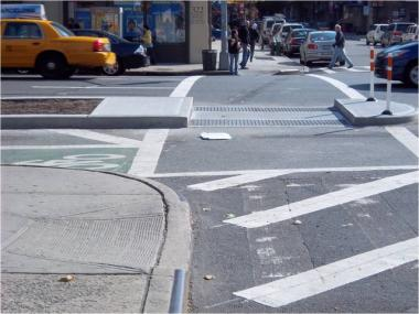 Some of the city's new bike lane configurations have moved crosswalks past sidewalks.