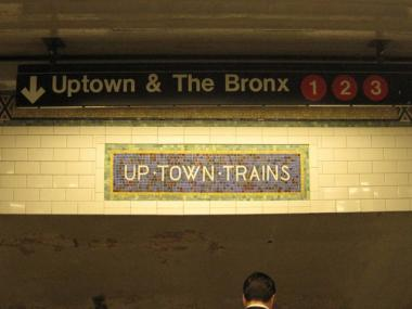 A woman was hospitalized after landing on the Uptown 2/3 line at 42nd Street and 7th avenue Wednesday.
