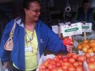 Marcia Bailey shops at a farmers market outside of Rangel's 125th Street office.
