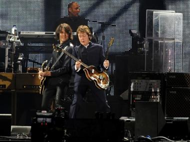 Paul McCartney performing at the UK's Isle of Wight festival. The musician will play the Apollo Theater in December.