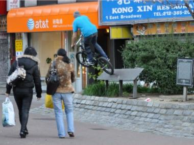 A cyclists rides on top of a commemorative plaque at the so-called