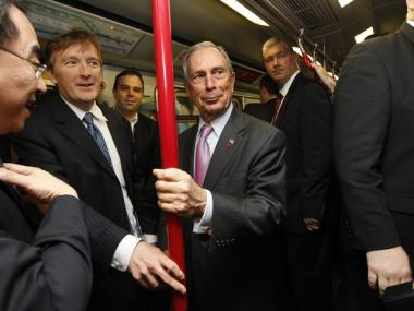 Mayor Bloomberg takes a ride on Hong Kong's Mass Transit Railway Saturday. He says U.S. voters elected politicians who