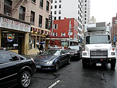Delivery trucks are forced to double park along Third Avenue, causing them to get ticketed even when parked along a spot for commercial vehicles.