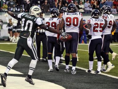 Santonio Holmes celebrates after catching the winning touchdown pass against the Texans Sunday.