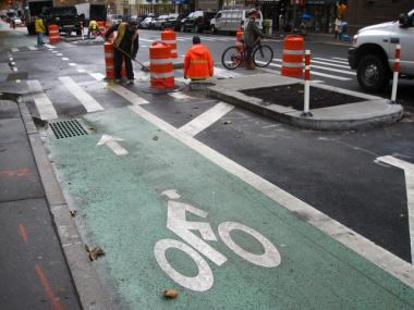 Columbus Avenue's new bike lanes are part of a larger redesign of the street. Concrete islands (at right) will shorten crossing distances for pedestrians.