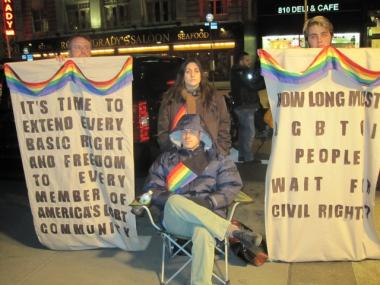 Bounville and DiBona (center) with fellow activists in front of the midtown Sheraton Thursday night.