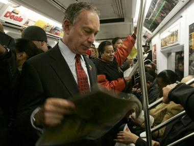 Mayor Michael Bloomberg rides the subway. A member of his security detail has been charged with shooting a rival in a lover's triangle.