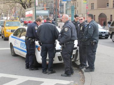 Police gathered at the corner of First Avenue and East 14th Street Friday to discuss details of the recent muggings at Stuyvesant Town and Peter Cooper Village.