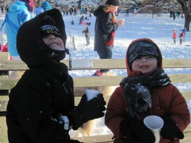 Gavin Nelson, 5, enjoys some free hot chocolate with his brother Eli, 3, at Riverside Park.
