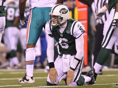 Mark Sanchez picks himself up after an incomplete pass against the Miami Dolphins at New Meadowlands Stadium on Dec. 12, 2010.