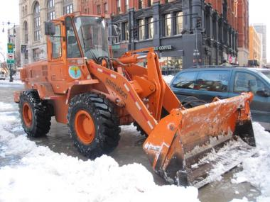 A snow plow stands parked outside of City Hall after the blizzard of 2010.
