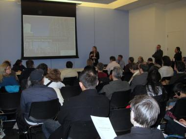 City Planner Erika Selke address Hell's Kitchen residents and Community Board 4 members.