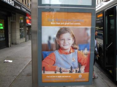 A bus shelter ad for Upper West Success Academy, the charter school that could open inside the Brandeis High School building on West 84th Street.
