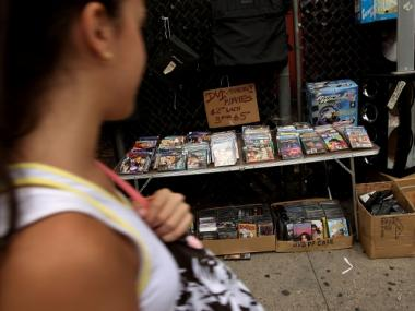 Police have confiscated 8,748 illegal DVDs for sale around Canal Street since last March.