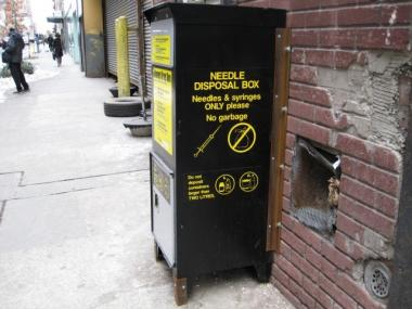 A metal box on West 37th Street allows people to drop off needles.