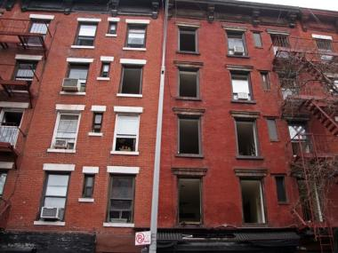The windows above the fire at 507 E. 6th St. were shattered Tuesday.