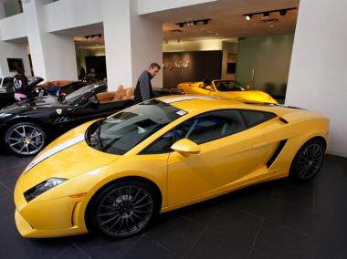 A Lamborghini, one of the muscle cars that could be up for grabs at the Classic Car Club's new Upper East Side location, sits on a showroom floor in Chicago.