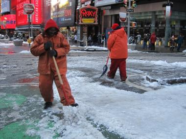 Brooklyn's Derrick Davis, 44, breaks up packed snow in Times Square on Jan. 21