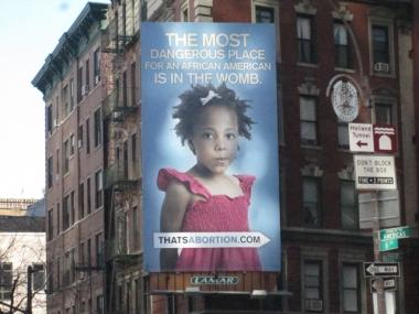 A three-story billboard has drawn criticism from SoHo residents for its abortion message aimed directly at minority women.
