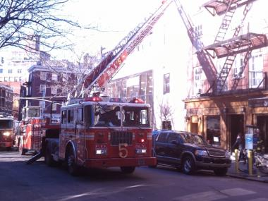 Firefighters battled a small blaze on the roof of a Chase Bank near NYU.