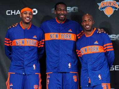 Carmelo Anthony (l.), and Chauncey Billups (r.) pose for photographs with new teammate Amar'e Stoudemire (c.) before their first game in a Knicks uniform against the Milwaukee Bucks on Feb. 23, 2011.