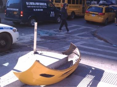 The bumper of a taxi cab was seen in the bike lane on Eighth Avenue at West 17th Street.