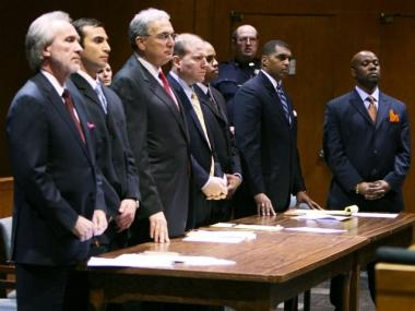 Detective Michael Oliver (2nd L) Detective Gescard Isnora (3rd R) and Detective Marc Cooper (R) stand during their arraignment at State Supreme court March 19, 2007 in the Queens borough of New York City. Oliver and two other New York Police detectives were charges in the shooting of Sean Bell November 2006.