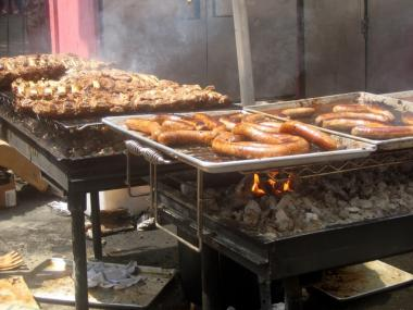 Grilling at the annual Big Apple BBQ, which organizers want to bring back this year.