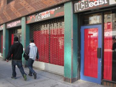 Neighbors are upset over red curtains that were recently added to the windows of the Upright Citizens Brigade's forthcoming theater space on Avenue A.