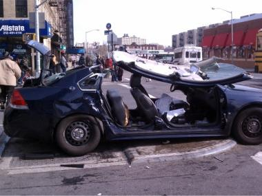 The remains of a police car involved in a car accident at 145th Street and Adam Clayton Powell Blvd.