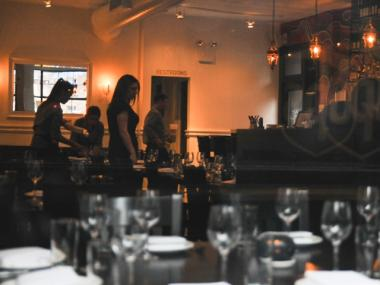 Restaurant servers could be seen setting up tables for dinner service Monday evening.
