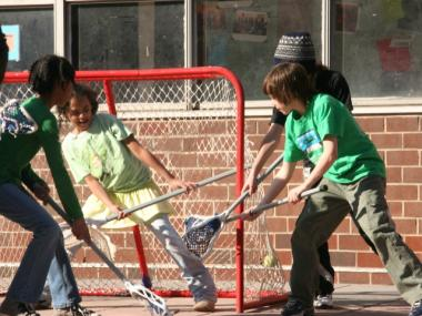 Lacrosse is just one of the many sports offered at P.S. 150's after-school program.