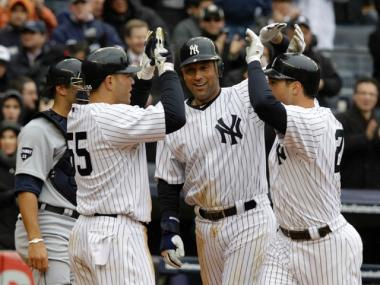 Yankees Russell Martin, Derek Jeter and Mark Teixeira celebrate Teixeira's home run during the Yankees home opener on March 31, 2011.