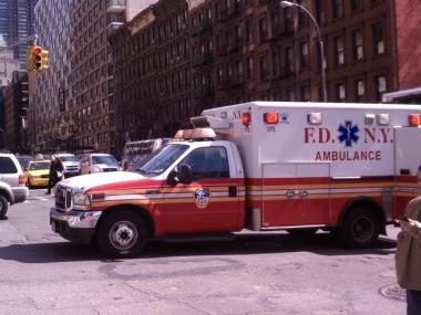 A Fire Department ambulance responds to the scene at West 57th Street and 10th Avenue.