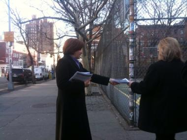 City Council Speaker Christine Quinn hands out flyers looking for information about an alleged anti-gay attack at a McDonald's on the corner of 3rd Street and Sixth Avenue.