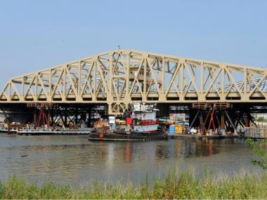 Crews work to install the new Willis Avenue Bridge as it's placed into its permanent position over the Harlem River August 9, 2010 in New York City. The 350-foot long pre-fabricated span is replacing the 109 year-old swing bridge currently in use.