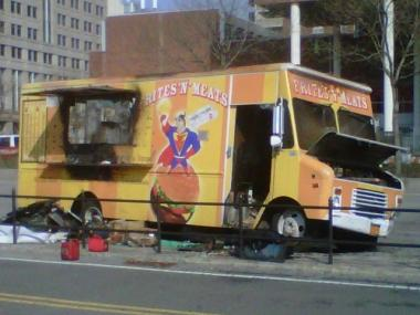 A Frites 'N' Meats food truck burst into flames after colliding with another vehicle Monday.