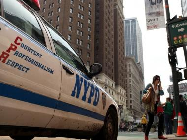 A woman walks by a New York City Police Department vehicle on April 6, 2010 in New York City.