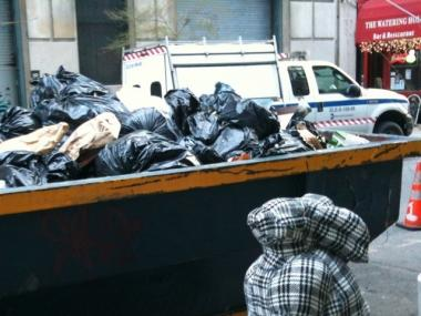 A dumpster on 19th Street behind the National Arts Club was overflowing with bags of garbage on a recent day.